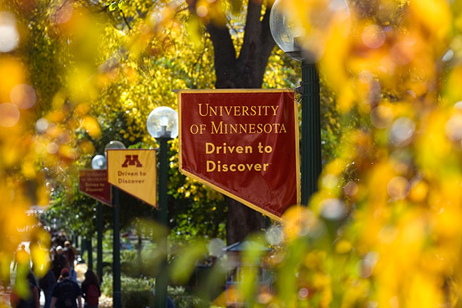 "Image of ""Driven to Discover"" maroon banner on the University of Minnesota Campus"